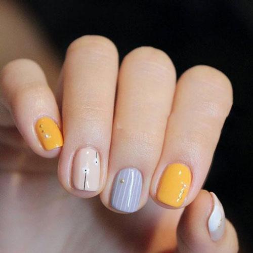 دیزاین دست با لاک خاکستری و زرد ترکیبی